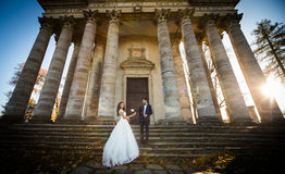 Panoramic view of a fairytale newlywed couple holding hands Royalty Free Stock Photos