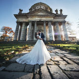 Panoramic view of a fairytale newlywed couple hugging and kissin Stock Photo