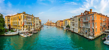 Panoramic view of famous Canal Grande and Basilica di Santa Maria della Salute at sunset in Venice, Italy Stock Photography