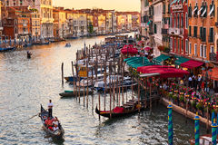 Panoramic view of famous Canal Grande from famous Rialto Bridge at sunset in Venice. Royalty Free Stock Photo