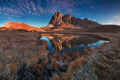 Panoramic view of famous Dolomites mountain peaks and lakes glowing in beautiful golden morning light at sunrise in summer. stock photos