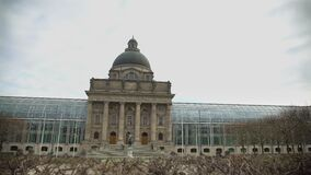 Panoramic view on famous glass State Chancellery near Hofgarten in Munich. Stock footage stock video