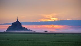 Panoramic view of famous Le Mont Saint-Michel tidal island in be. Autiful sunrise foggy light, Normandy, northern France Royalty Free Stock Photos