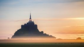 Panoramic view of famous Le Mont Saint-Michel tidal island in be. Autiful sunrise foggy light, Normandy, northern France Royalty Free Stock Photo