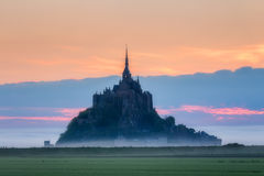 Panoramic view of famous Le Mont Saint-Michel tidal island in be. Autiful sunrise foggy light, Normandy, northern France Royalty Free Stock Photography
