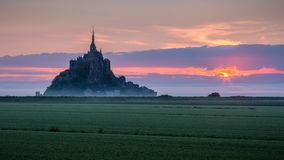 Panoramic view of famous Le Mont Saint-Michel tidal island in be. Autiful sunrise foggy light, Normandy, northern France Stock Images