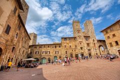 Panoramic view of famous Piazza della Cisterna in the historic town of San Gimignano on a sunny day, Tuscany, Italy royalty free stock photography