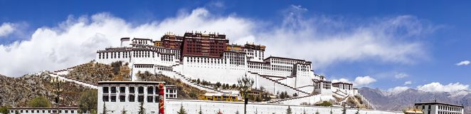 Panoramic view of Potala palace, former Dalai Lama residence in Lhasa - Tibet. Panoramic view of famous Potala palace. World Heritage site, former Dalai Lama Stock Photo