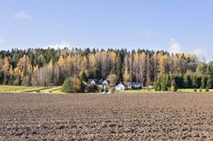 Panoramic view of farm with neatly plowed field royalty free stock photo