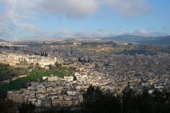 Panoramic view of Fes city under blue sky and white cloud, in morocco. City of Fes in Morocco. City known for its labyrinth streets Stock Photos