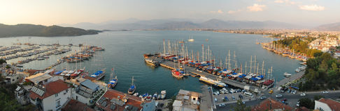 Panoramic view of Fethiye, Turkey in the afternoon. Panoramic view of the boats and surrounding dock at Fethiye, Turkey in the afternoon Stock Photos