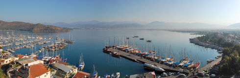 Panoramic view of Fethiye, Turkey in the morning. Panoramic view of the boats and surrounding dock at Fethiye, Turkey in the morning Stock Photography