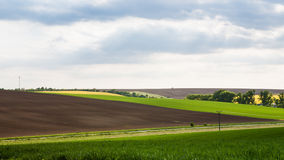 Panoramic view of fields in spring time Stock Photography