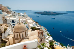Panoramic view of Fira and volcano on the island of Thera(Santorini), Greece. Stock Images