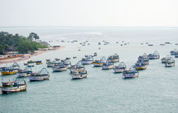 Panoramic view of fishing trawlers anchored in sea. A scenic and panoramic view of a number of fishing trawlers anchored at sea coast Stock Photo