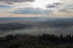 Panoramic view of Florence from Fiesole. Sunbeams are coming through clouds, Tuscany, Italy royalty free stock photo