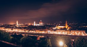Panoramic view of Florence at night with Palazzo Vecchio and Florence Cathedral from Michelangelo Square stock photo