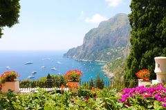 Panoramic view from flower garden terrace on Capri bay, Italy.  royalty free stock images
