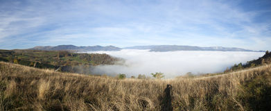 Panoramic view of foggy morning in the mountains Royalty Free Stock Images