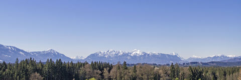 Panoramic view from the foothills of the Alps. Look at Herzogstand, Zugspitze and home garden from the foothills landscape around Penzberg Royalty Free Stock Images