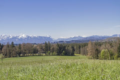 Panoramic view from the foothills of the Alps. Look at Herzogstand, Zugspitze and home garden from the foothills landscape around Penzberg Stock Photo