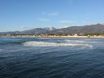 Panoramic view of Forte dei marmi coast with Apuan alps in background in winter . Tuscany, Italy.  royalty free stock photos