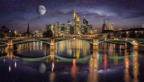 Panoramic view of Frankfurt, Germany at night with moon and stars on the sky reflecting in the river Main. Panoramic view of Frankfurt, Germany at night with stock photography