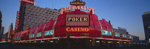 Panoramic view of Fremont Casino and Neon sign at dusk in Las Vegas, NV Stock Photography