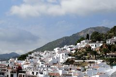 Panoramic view of Frigiliana - Spanish white village Andalusia. Beautiful and charming with its narrow streets and footpaths white village Frigiliana, close to Stock Images