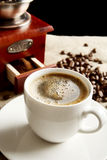 Panoramic view of frothy coffee cup with beans on fabric flax Royalty Free Stock Images
