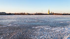 Panoramic view of frozen Neva river and Fortress. Panoramic view of frozen Neva river and Peter and Paul Fortress in Saint Petersburg city in March evening Stock Photos