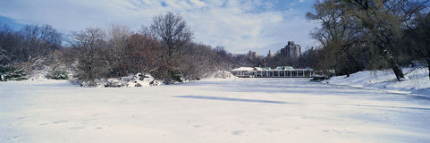 Panoramic view of frozen pond in Central Park, Manhattan, New York City, NY after winter snowstorm Royalty Free Stock Photo