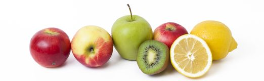 Panoramic view of fruit on white background. Fruits on a white background. Lemon with apples and kiwi on white background. stock photo