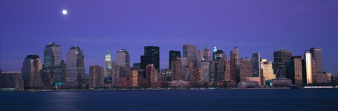 Panoramic view of full moon rising over lower Manhattan skyline, NY where World Trade Towers were located Royalty Free Stock Photos