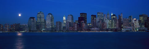 Panoramic view of full moon rising over lower Manhattan skyline, NY where World Trade Towers were located Royalty Free Stock Images