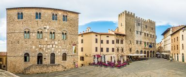 Panoramic view at the Garibaldi place with building of Museum and Town hall in Massa Marittima - Italy stock images