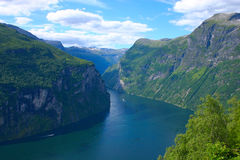 Panoramic View Geiranger Fjord - Horizontal. The Geiranger fjord is one of Norway's most visited tourist sites and has been listed as a UNESCO World Heritage Royalty Free Stock Image