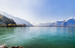 Panoramic view of Geneva lake and Chillon castle among mountains in Switzerland Royalty Free Stock Photography