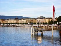 Panoramic view of Geneva skyline with traditional boat at harbor district, Canton of Geneva, Switzerland stock images