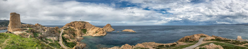 Panoramic view of Genoese tower and lighthouse at Ile Rousse in Stock Images
