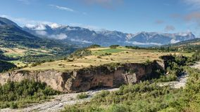 Glacial rock near Embrun - Alpes - France. Panoramic view of a glacial rock near Embrun and Chateauroux- Hautes-Alpes - France Royalty Free Stock Images