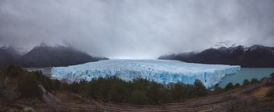 Panoramic view of glacier on cloudy day royalty free stock photos