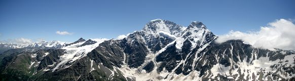 Panoramic view of Glacier Seven on the mountain Donguz-Orunbashi. A view of the surroundings from the Che-Get mountain near Elbrus. Russian and the Caucasus Royalty Free Stock Images