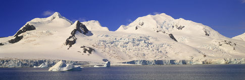 Panoramic view of glaciers and iceberg in Paradise Harbor, Antarctica Stock Photography