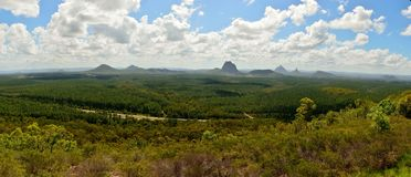 Panoramic view of Glass House Mountains in Queensland, Australia. Panoramic view of Glass House Mountains including Tibberoowuccum, Tibrogargan, Cooee, Beerwah Royalty Free Stock Photos