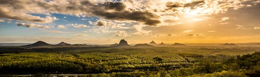 Panoramic view of Glass House Mountains at sunset visible from W Royalty Free Stock Images
