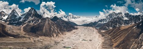 Panoramic view in the Gokyo Lakes region. Nepal. Breathtaking panoramic view in the Gokyo Lakes region. The mighty snow-covered mountain range on the way to the royalty free stock images