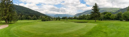 Panoramic view of golf course in Austria stock photography