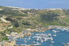 Panoramic view of Gozo`s island and bay. small villages around, boats royalty free stock image