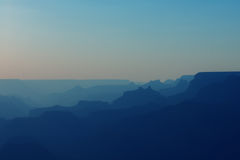Panoramic View of Grand Canyon in blue colors after sunset Stock Photo